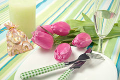 Setting the table on a holiday with flowers gift box Royalty Free Stock Photo