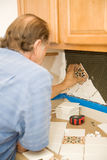 Setting Tiles with Care Stock Photos
