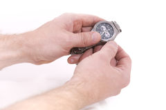 Setting the time. On a wrist watch Royalty Free Stock Image