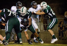 Setting up Blocks. Two linemen fight for position during a game.  Shasta College (green) played against Mendocino College   (white) September 13th, 2014 Stock Photos