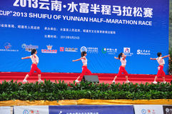 Setting-up exercise performance. Setting-up exercise edifice before the game, led the runners warm up.Half international marathon in fushui county in yunnan Royalty Free Stock Image