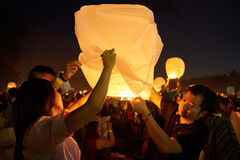 Setting up the lantern to the sky stock photography