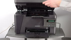 Setting up office printer stock footage