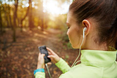 Setting up playlist for jogging Royalty Free Stock Images