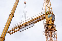 Setting up a tower crane Stock Images