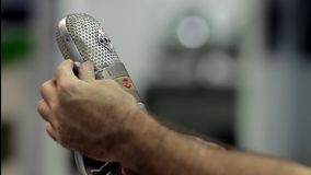 Setting Up The Vintage Microphone. In a Radio Studio stock footage