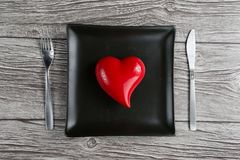 Setting for valentine& x27;s day romantic dinner. Top view. Space for. Text. Black background and romantic lighting stock image