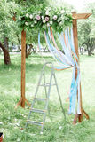 Setting of wedding arch - wedding arch and stepladder. Stock Photography