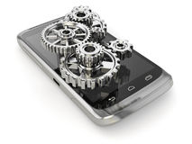 Settings of mobile phone. Gears on the screen. Royalty Free Stock Photo