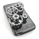 Settings of mobile phone. Gears on the screen. Royalty Free Stock Image