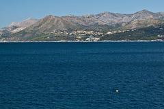 Settlement at the Adriatic coast, Croatia. Settlement at the Adriatic coast in front of mountains. Dubrovnik, Croatia Stock Images