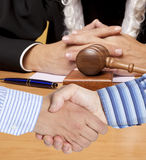 Settlement agreement. Against the background of judge Royalty Free Stock Photos