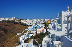 Settlement with beautiful white houses on the hill on Santorini Stock Photography