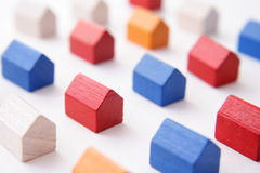 Settlement concept. Macro image of wooden houses in variety of colors royalty free stock photography
