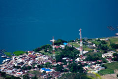 Settlement on the edge of lake Toba. Berastagi, Indonesia - July 9, 2017: Seeing the settlement of people on the edge of lake Toba from the hill Sipiso-piso Stock Photos