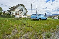 Settlement of few houses and an old car in front, near a highway in British Columbia, Canada stock images