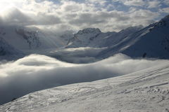 When in settlement a fog. The photo is made in the settlement of Dombai in the North Caucasus Stock Photo