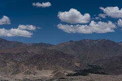 Settlement in the foothills of Himalayan  mountains in Ladakh.. Settlement marked by green in barren rugged mountain terrain of Ladakh. Ladakh is a cold desert Royalty Free Stock Image