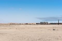 Settlement in front of the dunes of the Namib Desert on the eastern outskirts of Swakopmund.  Royalty Free Stock Images