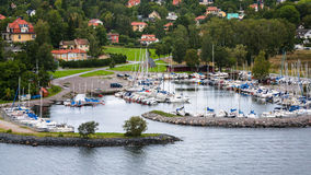 Settlement in green woods in suburbs of Stockholm Royalty Free Stock Image