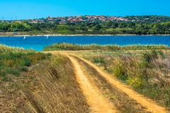 Settlement on Hill at the Coast of Istria in Croatia. Mediterranean Settlement on Hill at the Coast of Istria in Croatia royalty free stock images