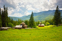 The settlement in the mountain meadow Stock Photos