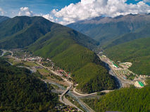 Settlement in Mountains. Aerial view of Krasnaya Poluana place (Sochi, Russia). The resort is slated to host the snow events (alpine and nordic) of the 2014 royalty free stock photo
