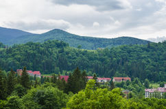 Settlement in the mountains. A resort village in the Carpathians Royalty Free Stock Images
