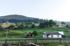 Settlement in the mountains. The village is located on the hills. Life in the mountains Royalty Free Stock Images
