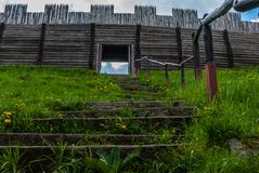 Settlement of palisade. Ancient settlement with a wooden stockade Royalty Free Stock Image