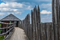 Settlement of palisade. Ancient settlement with a wooden stockade Stock Photos