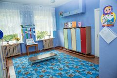 Room for changing clothes and lockers for personal belongings in kindergarten. royalty free stock photography