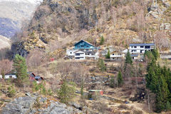 Settlement on the slope of rock in Sognefjord Stock Photography