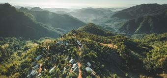 Settlement among Thailand wild nature. Aerial shot royalty free stock photos