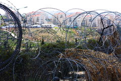 Settlement in West Bank behind barbed wire royalty free stock photography