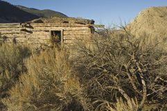 Settlers cabin in sage brush Stock Photo