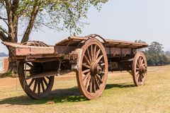 Settlers Ox Wagon. Settlers wood ox wagon closeup of ancient travel  vehicles in rural countryside Royalty Free Stock Photos