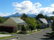 Settlers' Village. Early Settlers' Village, Stratford, New Zealand. The extinct volcano Taranaki (Mt Egmont) is in the background partially covered in cloud royalty free stock photos