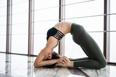 Setu Bandha Sirsasana. Beautiful yoga woman practice near window yoga room studio background. Yoga concept. Royalty Free Stock Image