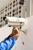 Setup cctv camera. On wall Royalty Free Stock Image