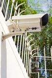 Setup cctv camera. On wall Stock Images