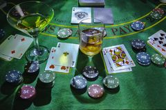 Setup for playing Blackjack at the Casino. WHisky and Martini glasses on the table royalty free stock images