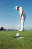 Setzen des Golfmannes Stockbilder