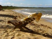 Setzen Sie auf den Strand u. entspannen Sie sich Stockfotografie