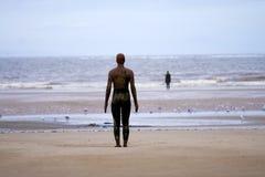 Setzen Sie Statue auf den Strand Lizenzfreie Stockfotografie