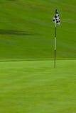 Setzendes Grün des Golfs stockbild