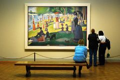 Seurat at the Art Institute of Chicago. Patrons a the Art Institute of Chicago ponder at the work of Georges Seurat stock image