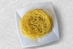 Sev crunchy noodle popular Indian namkeen snack food made from chickpea flour paste, turmeric, cayenne, and ajwain. Sev is a popular Indian snack food consisting stock photos