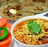 Sev tomato. Gujarati Thali consisting of Bajra roti and Tomato Sev and salad royalty free stock photos