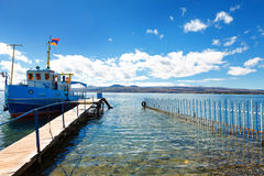 Sevan lake and white clouds blue sky on a sunny day, Armenia. The view on mountains from the pier of Sevan lake and white clouds on blue sky on a sunny day Royalty Free Stock Image